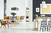 Multifunctional interior with green chair