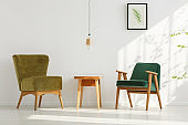 Stylish green chairs in room