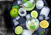 Healthy drink (juice) with lemon and ice in glass