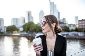 Businesswoman eating outdoors