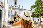 Woman traveling in Faro town on the south of Portugal