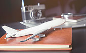 Toy plane on business office desk for business travel concept