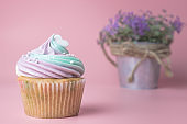 Purple lavender cupcake with lavender in background