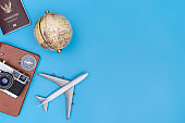 World Travel objects on blue copy space for travel concept