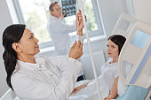 Nice professional doctor working with medical equipment