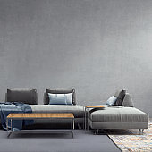 Interior with pastel gray colored sofa with blank wall