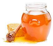 Jar full of fresh honey and honeycombs.