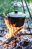 Cooking pot under the bonfire.