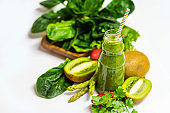 fresh green fruit and vegetable smoothie with kiwi, spinach, asparagus