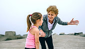 Senior sportswoman talking to little girl