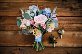 Beautiful bridal bouquet and boutonniere