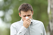 Man blowing in a wipe outdoors
