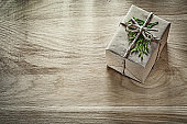 Handmade gift box with thuya branch on wooden board