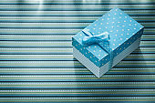 Gift box on stripy tablecloth celebrations concept