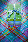 Gift in cardboard box on checked table cloth holidays concept
