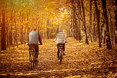 Couple Cycling in autumn park