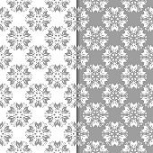 White and gray set of floral seamless patterns