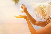 Woman applying sunblock protection