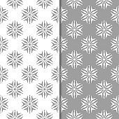 White and gray floral backgrounds. Set of seamless patterns