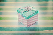 Wrapped present box on blue striped fabric holidays concept