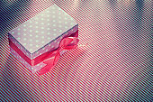 Wrapped present box on red striped tablecloth celebrations conce