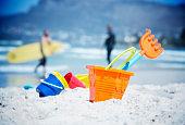 Beach buckets with surfer
