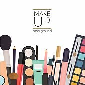 Makeup cosmetics and brushes on white background.