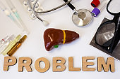 Liver problems concept photo. 3D figure of liver and gallbladder is near word problem and set of medical equipment and medicines. Idea of problems with normal vital activity, hormone and function