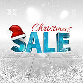 Christmas sale winter background with snowfall, snowflakes, Santa Claus hat and glitter.
