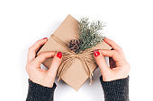 Woman's hands wrapping Christmas gift box