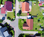 Blurry developed, new housing estate with houses and plots of land with gardens, aerial photo