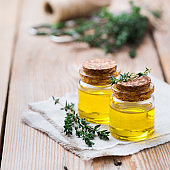 Organic essential thyme oil with green leaves