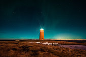 Iceland - Orange Lighthouse and Northern Lights