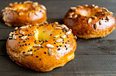 Bagels with seeds on a black background.