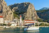 Boat at church at harbor in Cetina River Omis