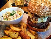 Tasty hamburger and french fries