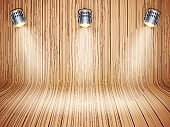 Curved wooden background with spotlights