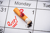 Cigarette on calendar. Time to quit smoking concept
