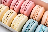 Colorful assorted macaroon cookies in a gift box