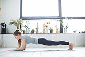 Woman practicing yoga, working out.