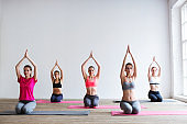 Group of people at the gym in a yoga class