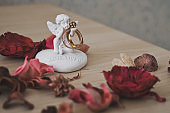 The figure of an angel with wedding rings 6225.