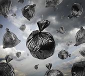 Black garbage bags in the stormy sky.
