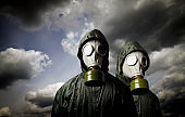 Two gas masks and dramatic sky. Survival concept.