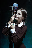 Portrait of a young girl in school uniform as a vampire woman