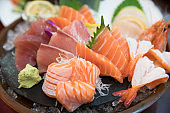 sashimi set with different fresh fish sliced on plate