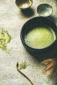 Flat-lay of freshly brewed Japanese matcha green tea in bowl