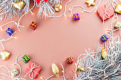 Colorful Christmas background with conifer cones, snowflakes, presents and Christmas lights on a warm background