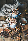 Hot chocolate with whipped cream, nuts, spices, cocoa powder