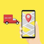 Hand holding mobile smart phone with app delivery tracking.